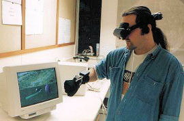 Interacting with a virtual world via head-mounted display and glove